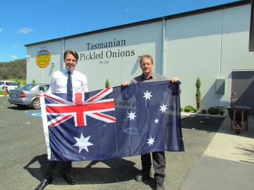Presenting a flag to iconic Tasmanian brand, Tasmanian Pickled Onions Pty Ltd